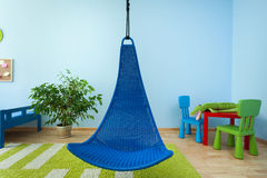 Hanging chair in child room Stock Images