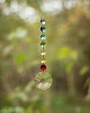 Hanging chakra crystals Stock Image