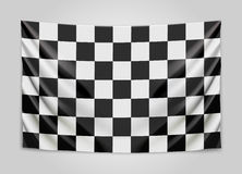 Hanging checkered flag. Race or winner flag concept. Stock Photography