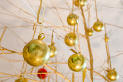 Hanging Chrismas golden ball ornaments Stock Photos