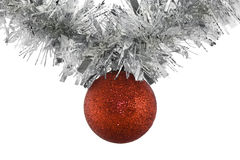 Hanging Christmas Ball. A red Christmas ball hanging from a garland Stock Photos