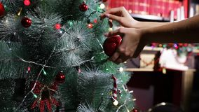 Hanging a Christmas ball,  Christmas tree stock footage