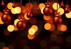 Hanging Christmas balls on bokeh background Stock Photos