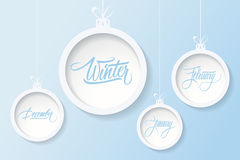 Hanging christmas balls with handwritten text winter, december, january, february. Stock Photos
