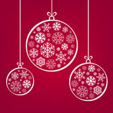 Hanging Christmas balls from snowflakes and ribbon. Eps 10 vector illustration on red background Royalty Free Stock Image
