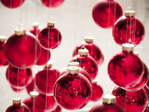 Hanging christmas baubles Royalty Free Stock Photos