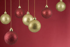 Hanging Christmas Decorations on Red Background Stock Image