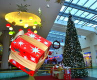 Hanging Christmas gift boxes shopping mall. Christmas presents and tree at shopping mall,Picture taken on November 21st,2014,Varna city,Bulgaria royalty free stock photo