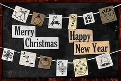 Hanging Christmas greeting paper ornament. On blackboard Stock Photos