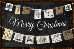 Hanging Christmas greeting paper ornament. On blackboard Stock Photography