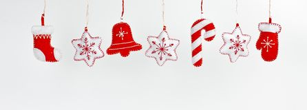 Hanging Christmas and New Year decorations on a white background Royalty Free Stock Photo