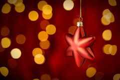 Hanging Christmas Ornament star lights background. Hanging Christmas Ornament star with sparkling lights in background royalty free stock photos