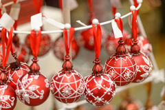 Hanging Christmas ornaments balls at shop. Hanging red and white Christmas ornaments balls at shop Royalty Free Stock Image