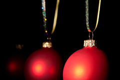 Hanging Christmas red baubles Royalty Free Stock Photo