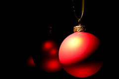 Hanging Christmas red baubles Royalty Free Stock Image