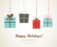 Hanging christmas and seasonal presents Royalty Free Stock Images