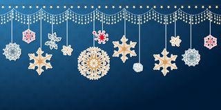 Hanging Christmas snowflake border. Various hanging Christmas snowflake in versatile border isolated on blue. Winter holiday card