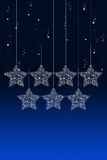 Hanging Christmas star with snow Royalty Free Stock Photo