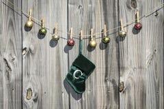 Hanging Christmas Stocking and Balls Fence Stock Image