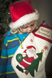 Hanging the christmas stocking Royalty Free Stock Images