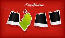 Hanging Christmas tree badge and photographs. Royalty Free Stock Photo