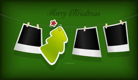 Hanging Christmas tree badge and photographs. Stock Image