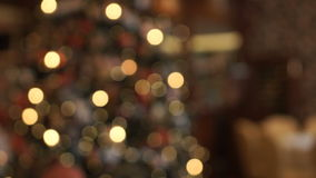Hanging on the Christmas tree garlands sparkle brightly. Bokeh stock footage