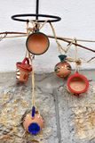 Hanging clay jugs and cups on the wall Stock Photo