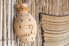 Hanging clay pot. In desert camp Oman stock images