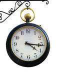 Hanging clock. A hanging vintage clock with a golden ring stock photography