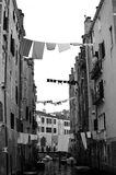 Hanging clothes. Over a venetian canal Royalty Free Stock Photo