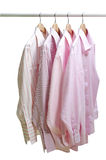 Hanging clothes. Hanging of formal clothes on white background Stock Photo
