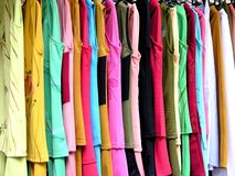 Hanging clothes. Colorful hanging clothes royalty free stock image
