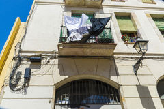 Hanging clothes in Barcelona. Hanging clothes outside a small balcony of old building in the old town of Barcelona, Catalonia, Spain Stock Photo