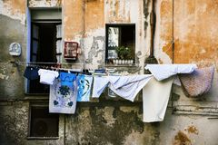 Hanging clothes in the old town of Cagliari, Italy. Clothes hanging in some clothes lines outdoors in an old building, in the old town of Cagliari, in Sardinia stock photography