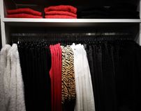 Hanging clothes for women with shelf above stock photos