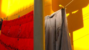 Hanging Clothes on Yellow Wall stock footage