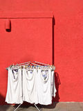 Hanging Cloths. Against red wall Royalty Free Stock Images