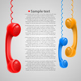 Hanging colored handsets Royalty Free Stock Image