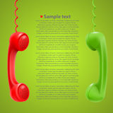 Hanging colored handsets Stock Images