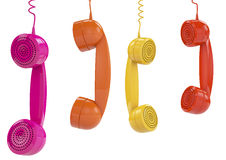 Hanging colored handsets Stock Photo