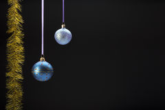 Hanging colorful christmas balls on black Royalty Free Stock Photos
