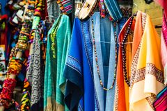 Hanging colorful dresses. With weaves and necklace stock images