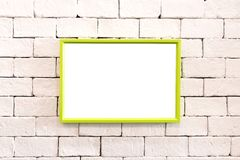 Hanging colorful photo frame on brick wall in loft concept style. Blank vivid border for your design or show at gallery room. Hanging colorful photo frame on stock photography