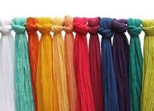 Hanging colorful silk fabrics stock photos