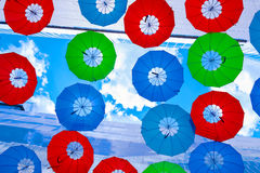 The hanging colorful umbrellas. Between the building Stock Photos