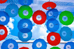 The hanging colorful umbrellas. Between the building Royalty Free Stock Photo