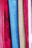 Hanging coloured materials. Hanging brightly coloured materials and textiles royalty free stock images