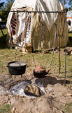 Hanging Copper Kettle and Iron Pot. Authentic Early American campsite with a cooking pot and kettle over a cooking fire.  Feast of the Hunter's Moon period re Royalty Free Stock Photos