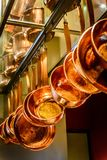 Hanging copper pots, pans, saucepans. Hanging gleaming copper pots, pans, saucepans in open concept kitchen Royalty Free Stock Images